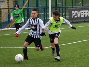 u12s International Shea O'Hare battles for the ball