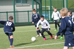 CYFC 11s Michael weaves through against Portadown Youth.