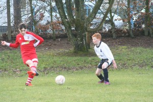U15s William Kenning has only eyes for the ball against Enniskillen Rangers.
