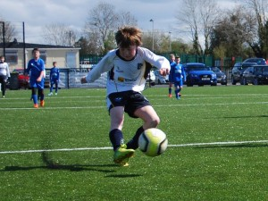 CYFC 12s player unleashes a fierce shot against Loughgall Youth.