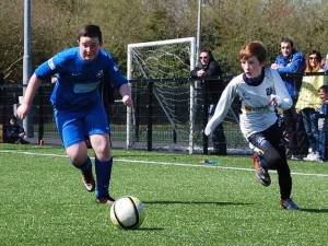Its a race for the ball between Loughgall and CYFC 12s.