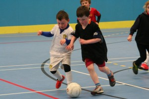 Two young stars of the future battle for the ball at the Development Centre last Friday evening.