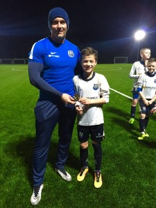 U12s Man of The Match Shea O'Hare is congratulated by manager Ryan Hamilton.