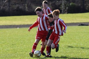CYFC player in the middle of a Derry Colts sarnie 11.02.2017.